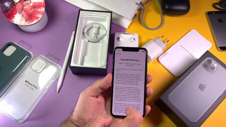 Paris, France - Sep 20, 2019: Face ID and Privacy contract reading as man Man hand unboxing unpacking highly acclaimed new Apple Computers iPhone 11 Pro and 11 Pro Max smartphone triple-lens camera