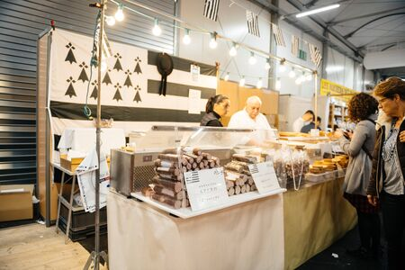 Strasbourg, France - Feb 16, 2020: Andouille Apero Bretagne sweets visitors people at French wine at the Vignerons independant English: Independent winemakers of France wine fair