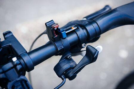 Shift lever change on modern bicycle handlebar steering wheel close-up macro shot