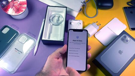 Paris, France - Sep 20, 2019: Restore apps and data as man hand unboxing unpacking highly acclaimed new Apple Computers iPhone 11 Pro and 11 Pro Max smartphone triple-lens camera