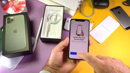 Paris, France - Sep 20, 2019: Switch between recent apps POV man hand unboxing unpacking highly acclaimed new Apple Computers iPhone 11 Pro and 11 Pro Max smartphone triple-lens camera