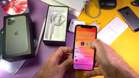 Paris, France - Sep 20, 2019: Search app menu POV man hand unboxing unpacking highly acclaimed new Apple Computers iPhone 11 Pro and 11 Pro Max smartphone triple-lens camera
