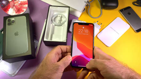 Paris, France - Sep 20, 2019: POV man hand holding after unpacking highly acclaimed new Apple Computers iPhone 11 Pro and 11 Pro Max smartphone triple-lens camera