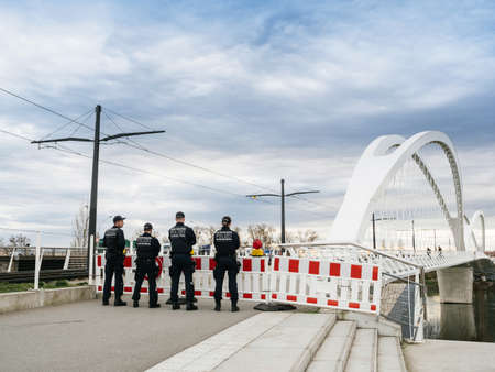 Kehl, Germany - Mar 16, 2020: German Polizei Police officers checks traffic at the border crossing in Kehl from France Strasbourg during crisis measures in the fight against coronavirus Editöryel