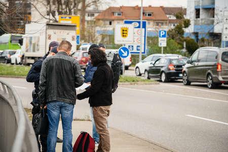 Kehl, Germany - Mar 16, 2020: German Polizei Police officers checks people at the border crossing in Kehl from France Strasbourg during crisis measures against novel coronavirus Editöryel
