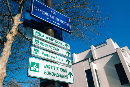 French street indicators in Strasbourg with La Wantzenau, Robertsau, Piste des Forts and Institution Europeens above Rue Francois-Xavier Richter