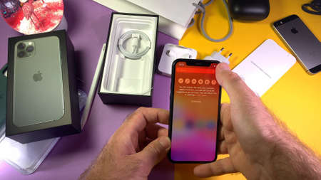 Paris, France - Sep 20, 2019: Press search all apps POV man hand unboxing unpacking highly acclaimed new Apple Computers iPhone 11 Pro and 11 Pro Max smartphone triple-lens camera 에디토리얼