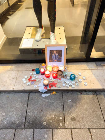 Strasbourg, France - Dec 12, 2018: view of tribute place on Rue des Grande Arcades in central Strasbourg after terrorist attack annual Christmas Market - candles near portrait of one of the victim