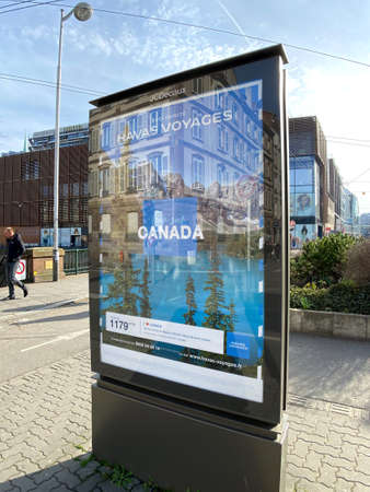 Strasbourg, France - Feb 8, 2020: Havas Voyage advertising board in central city with Canada trip advertising OOH