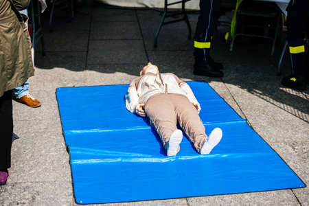Fire and rescue duty training manikins dummy with rescue emergency team nearby during a general training for exceptional situations