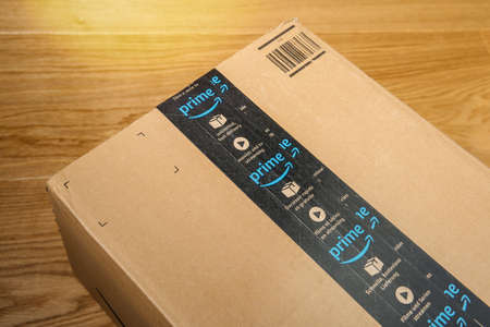 Close-up of double scotch tape on the Amazon Prime cardboard parcel - the company founded 30 years ago by Jeff Bezos