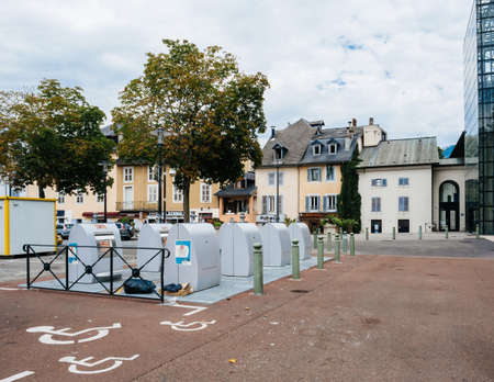 Waste recycling metallic containers in central square near disabled parking space Éditoriale