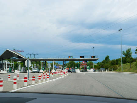Driver POV at the front gates of Peage Toll Road on the French highway Éditoriale