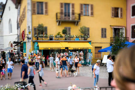 Tilt-shift lens over the busy city center of Annecy with Loto, Souvenirs, Tabac and Gifts