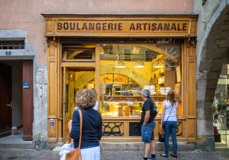 admiring the bread and sweets in front of the iconic Boulangerie Artisanale bakery store