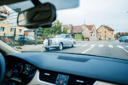 rench city with defocused view from inside the car at the luxury Rolls-Royce Éditoriale