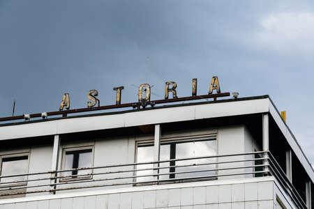 Rusty old vintage signage on the roof of hotel Astoria Éditoriale