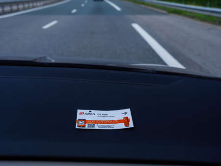 Toll Road operated by Area in Chambery Nord placed on the car dashboard