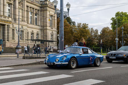 luxury vintage sport car during wedding ceremony convoy with The National Theatre of Strasbourg
