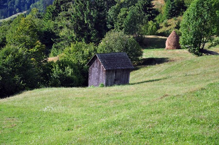 barrack: Old wooden barrack on a meadow Stock Photo