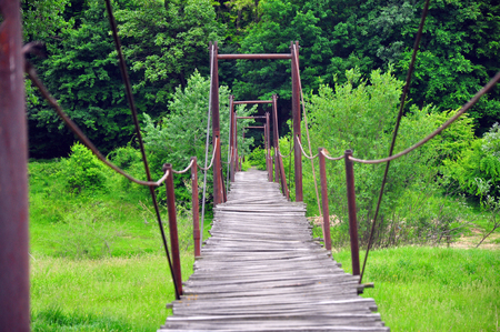 Footbridge: Wooden footbridge over a river