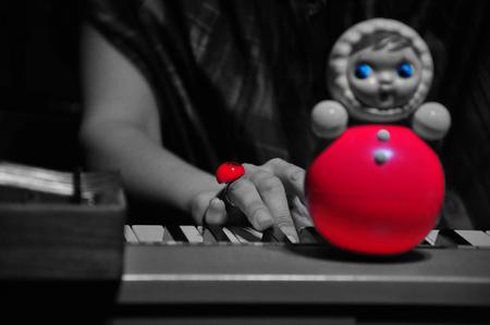 matrioshka: Matrioshka sitting on a piano