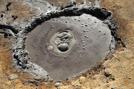 erupting: Mud volcano erupting from the soil Stock Photo