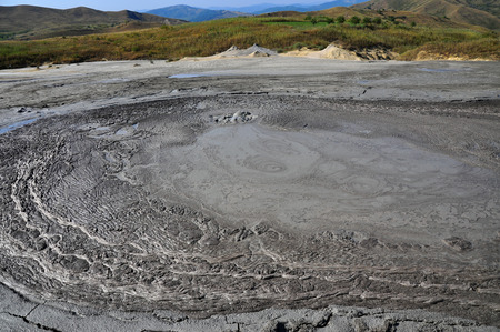 huge: Huge gray mud volcano erupting