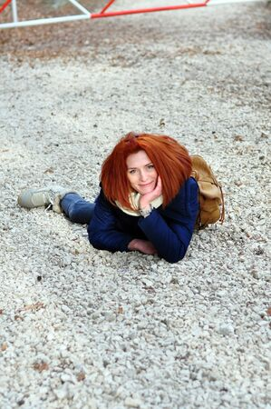 red head woman: Red head woman lying on the ground
