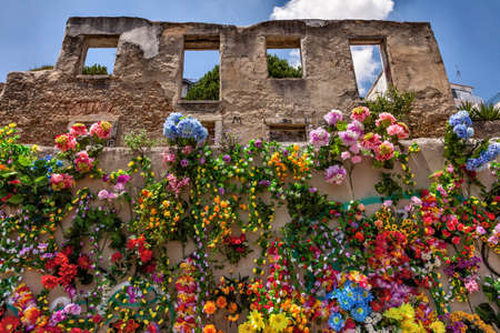Wall covered with fake multicolored flowers