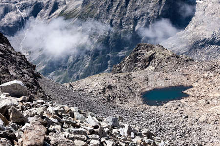 high mountain pond in a basin between the rocks Stok Fotoğraf