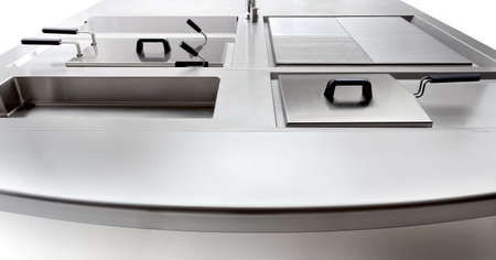 the cooktop of a professional stainless steel kitchen