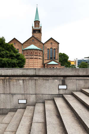 stone staircase in the background of a brick church