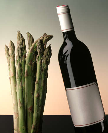 bottle of wine with asparagus on a gradient background