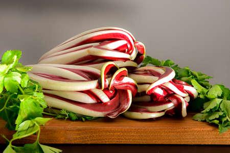 trevisano red radish and celery on a wooden board 版權商用圖片