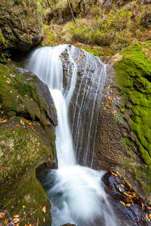 little waterfall of a mountain stream with magic effects 版權商用圖片