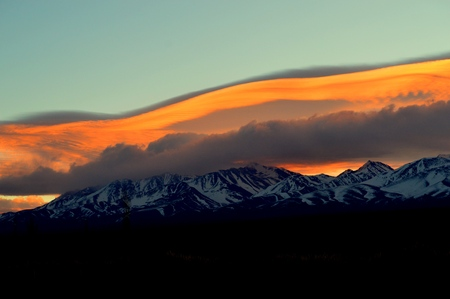 Natural mantle of clouds covers the Andes mountain range in Mendoza, Argentina