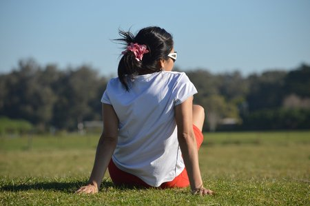 Young woman rests on the grass in the park Camet of the city of Mar del Plata, Argentina Stock Photo