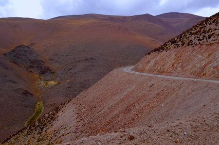 Cornice road ascends the slope of the Acay in Salta, Argentina Фото со стока