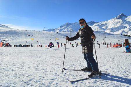 Young woman having fun skiing at Las Lenas as ski resort in Mendoza, Argentina