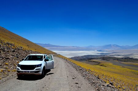 Road that goes up from La Chanceidad mine to Julia mine on Cerro Estrella. The R?o Grande salt flat is seen from behind. Jump. Argentina. 스톡 콘텐츠