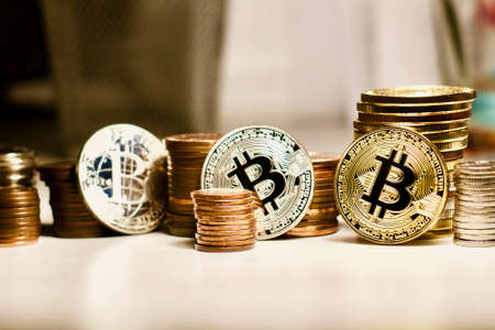 Three bitcoin coins Фото со стока