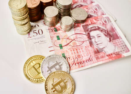 Bitcoin coins and pounds