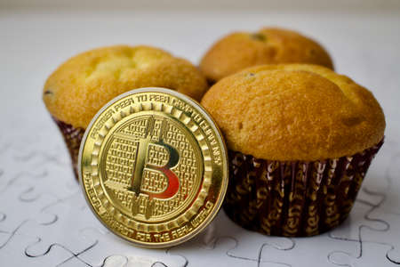 Bitcoin cryptocurrency with sweet cupcakes