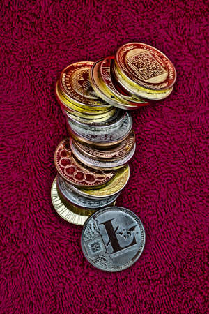 Digital currency physical coins, litecoin, bitcoin, dogecoin. Stock fotó