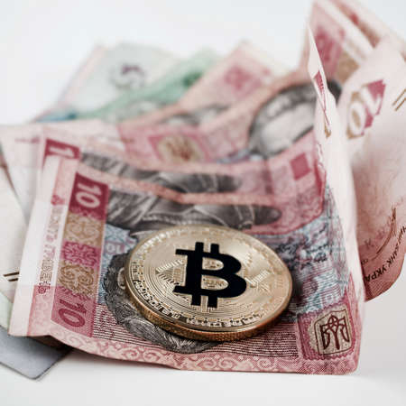 Cryptocurrency gold bitcoin coin and money from Ukraine.