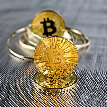 silver coins: Digital currency physical gold bitcoin coins. Silver background concept.