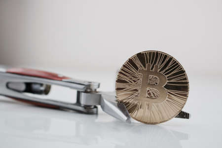Cryptocurrency physical gold bitcoin coin and pocket knife. Mens toys.