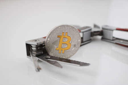 Digital currency physical silver bitcoin coin and pocket knife. Mans toys.