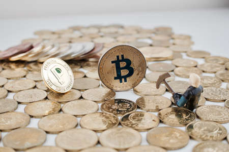 Digital currency physical gold bitcoin and peercoin near miner on the money.